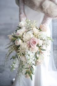 white wedding bouquets exquisite cascading ivory and pale pink winter wedding bouquet