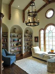 eclectic library with arched bookshelf by beckwith interiors
