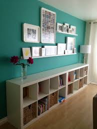 How To Make A Gallery Wall by Gallery Wall With White Frames And Floating Shelves For Creative