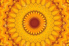abstract fractal kaleidoscope in bright warm colors of yellow