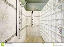shower with glass block wall and tile trim stock photo image