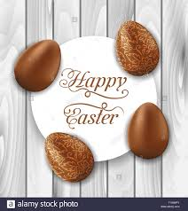 greeting card with easter chocolate ornamental eggs on wooden ba