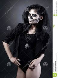 halloween background long young woman in day of the dead mask skull halloween face art
