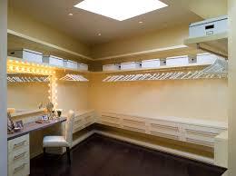 dressing room lights closet traditional with beige carpet beige