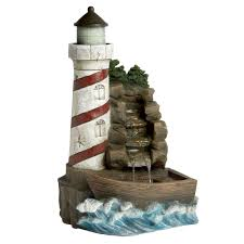 decorative lighthouses for in home use lighthouse in the rocks garden fountain christmas tree shops
