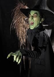 what is the origin of the pointed wizard witch hat of the sort