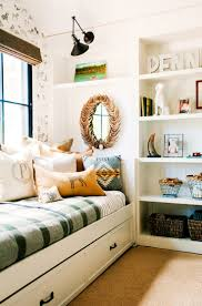 best 25 built in daybed ideas only on pinterest designer tours built in bookshelf in little boys room with daybed and lots of pillows
