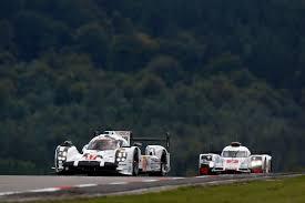 porsche 919 hybrid 2015 mark webber both porsche 919 hybrids on front row for home race