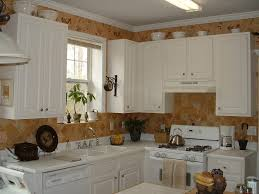 How To Decorate Above Cabinets by Ideas For Decorating Above Kitchen Cabinets Black Stove Dark