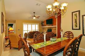 tropical dining room with ceiling fan u0026 metal fireplace in orlando