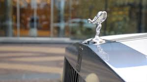 the spirit of ecstasy on a rolls royce car royalty free stock