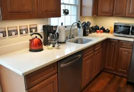 maple cabinets with white countertops dupont zodiaq countertop installation review one project closer