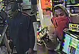 two men one in obama mask wanted for armed robbery at gas