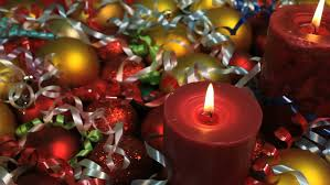 glowing candle with tree decorations and