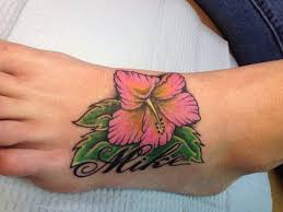 purple ink hawaiian hibiscus flower tattoo on upper arm