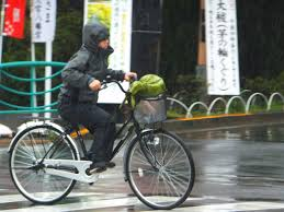 cycling raincoat police in japan give cyclists free raincoats tokyo by bike