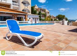 Outdoor Pool Furniture by Deck Chair In A Swimming Pool Stock Photos Image 33795343