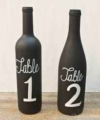 gold wine bottle table numbers chalkboard wine bottle table numbers set of 10 by belle amour