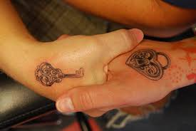 beautiful king and queen tattoos on hands for couple