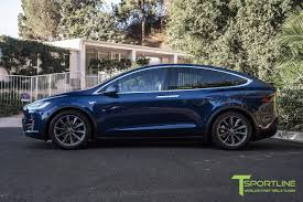 suv tesla blue model x with 20