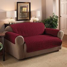 red leather reclining sofa together with protector cover also pier