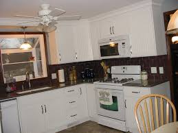 cabin remodeling white cabinet dark countertop kitchen backsplash