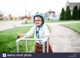 a toddler wearing a halloween costume of an elderly woman in