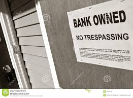 real estate foreclosure bank owned sign on house royalty free
