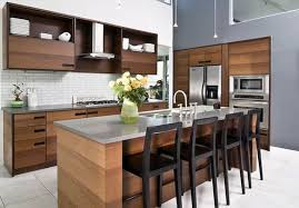 wooden island with stainless steel countertop dark wooden cabinets