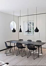 stripes compliment the different silhouettes of the hanging lights