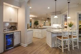 kitchen island dining custom design semi custom cabinets peninsula breakfast bar in white shaker cabinets in open kitchen with furniture look island
