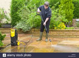 Cleaning Patio With Pressure Washer Man Jet Washing A Patio Stock Photo Royalty Free Image 38011536