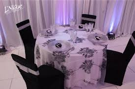 black ruched chair cover over chiavari chair specialty linen rental