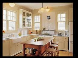 white kitchen cabinets with white appliances christmas lights