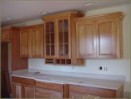 is it hard to install kitchen cabinets ebony wood ginger shaker door kitchen cabinets crown molding