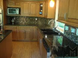 how to do a backsplash in kitchen river pebble tile kitchen backsplash a diy project anyone can do