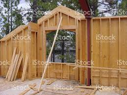 wall framing construction with steel post and window stock photo