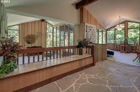 Midcentury Modern - modern entryway with exposed beam u0026 wood paneling in damascus or