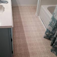 bathroom tile wainscoting with shower curtains and sink also bath