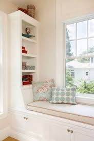 Window Bench Seat With Storage Simple White Bedroom With A Window Between White Shelves Dream