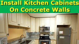 how to fix kitchen base cabinets to wall how to install kitchen cabinets on concrete brick walls drywall