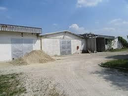 cerco capannone in vendita industriale con abitazione e terreno edificabile