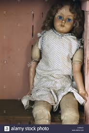 on the shelf doll doll sitting on a shelf stock photo 10283954 alamy
