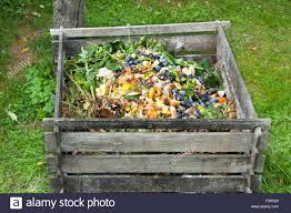 composter stock photos composter stock images alamy compost bin in the garden composting pile of rotting kitchen fruits and vegetable scraps