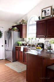 how to paint cherry wood cabinets crushing on my favorite things april cherry cabinets