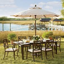 target patio heater exterior dark wood patio furniture on natural green grass and
