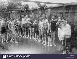 boys shower at a public bathing facility new york 1912 stock