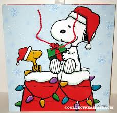 snoopy christmas dog house snoopy woodstock on doghouse christmas gift bag collectpeanuts