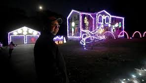christmas light display synchronized to music the day video alight for a christmas cause news from