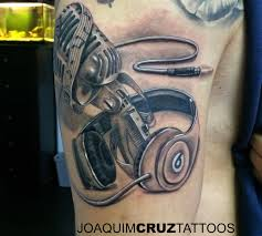 hand on shoulder tattoo 27 microphone and headphone tattoos